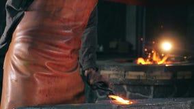 Forgeman is hammering metal in slow motion. HD stock video