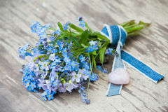 Forget-me-not. And cuckoo flowers with heart Royalty Free Stock Photos