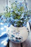 Forget-me-not flowers. On a wooden table Stock Images