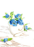 Forget me not flowers Easter egg decoration. Forget me not flowers and Easter egg. Holidays decoration Royalty Free Stock Photo