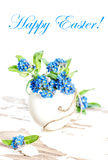 Forget me not flowers Easter egg Holidays decoration. Forget me not flowers and Easter egg. Holidays decoration. Sample text Happy Easter Royalty Free Stock Image