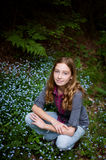 Forget-me-not flowers and a pretty girl Stock Photography