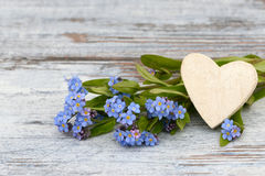 Forget me not and heart Stock Photo