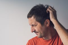 Forgetful absent-minded man Stock Images