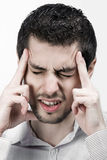 Forgetful businessman. Young attractive business man with headache or concentrating Stock Image
