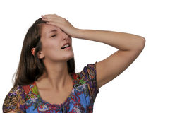 Forgetful woman. Beautiful forgetful woman with her hand on her forehead Stock Photo