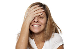 Forgetful woman. Smiling young woman forgot something Royalty Free Stock Images