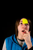 Forgetting. Forgetful guy with a sticky note on his forehead, a concept Royalty Free Stock Photo