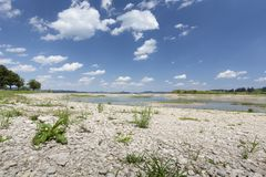 Forggensee lake in Bavaria, Germany, without water. Waterless Forggensee lake in Bavaria, Germany, with some plants growing again royalty free stock photo