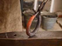Forging. Metal in an old forge on an anvil Royalty Free Stock Photography