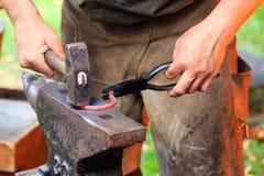 Forging a horse shoe Royalty Free Stock Photos