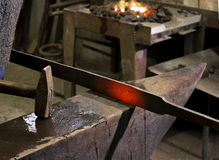 Forging hot iron. On the old anvil Stock Photos