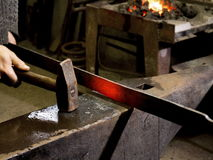 Forging hot iron. On the old anvil Royalty Free Stock Photography