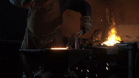 Forging hot metal in smithy stock footage