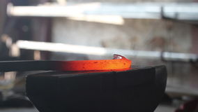 Forging hot metal in smithy stock video footage