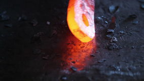 Forging hot metal in smithy stock video