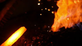 Forging a Sword in a Workshop stock footage