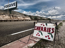 Forgive the Cherries. Curious combination of signs in the roads of New Mexico Stock Photos