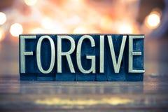 Forgive Concept Metal Letterpress Type. The word FORGIVE written in vintage metal letterpress type on a soft backlit background Stock Image