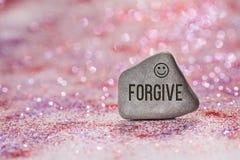 Forgive engrave on stone royalty free stock photos