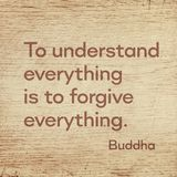 Forgive everything Buddha wood. To understand everything is to forgive everything - famous quote of Gautama Buddha printed on grunge wooden board royalty free stock images