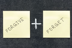 Forgive and forget. Words handwritten on sticker notes Royalty Free Stock Photos