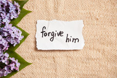 Forgive him, forgiveness concept on beautiful background with flowers Royalty Free Stock Image