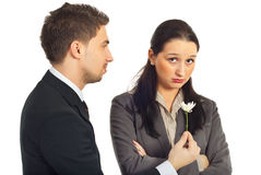 Forgive me!. Business man offering a little flower to his sad colleague woman with the message:Forgive me that i was wrong! isolated on white background Stock Photo