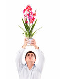 Forgive me, please!. A picture of a young man asking for forgiveness with flowers over white background stock photo
