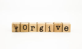 Forgive wording, ethic and merit concept Royalty Free Stock Photo