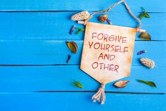 Free Forgive Yourself And Other Text On Paper Scroll Royalty Free Stock Photography - 121663637