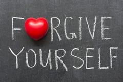Forgive yourself. Phrase handwritten on school blackboard Royalty Free Stock Images