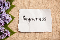 Forgiveness concept on beautiful background with flowers Royalty Free Stock Photos