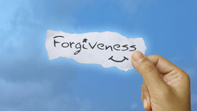 Forgiveness. Created Hand holding a Forgiveness note stock illustration