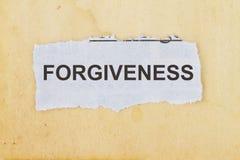 Forgiveness  newspaper cutout Stock Photography