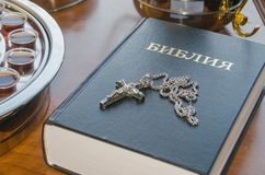Forgiveness ,the table, the pastor of the Church with wine and t. Table pastor of the Church with wine and the Russian Bible, for communion Stock Images