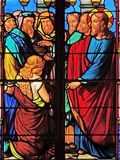 Forgiveness to the adulterous woman. Stained glass windows in the Saint Eugene - Saint Cecilia Church, Paris, France royalty free stock photo