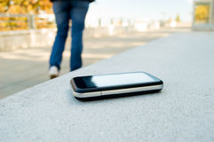 Forgot cell phone. Someone forgot cell phone on a bench in the park Royalty Free Stock Photography