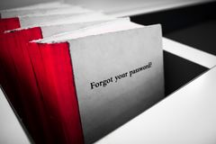Forgot your password selective color. Forgot your password. White book with red binding and phrase Forgot Your Password on the cover. Technology concept Royalty Free Stock Photo