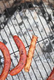 Forgoten sausages on a grill. Someone forgot four sausages on a grill, where the coal burn out Stock Images