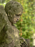 Forgotten. Old decrepit statue of a child royalty free stock images