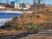 Forgotten. On the banks of the river children`s Bicycle Royalty Free Stock Images