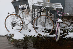 Forgotten bicycles left outside in the snow Royalty Free Stock Photography