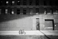 Forgotten bike. Bicycle locked by a street in Dumbo neighborhood Royalty Free Stock Photo