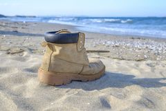Forgotten boot at the beach. Forgotten boot at the sandy beach Stock Photo