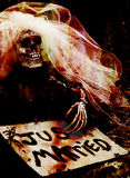 Forgotten bride. Skeleton bride with just married sign Royalty Free Stock Photos