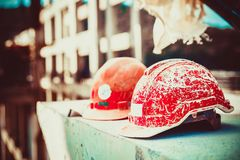 Forgotten builder helmet lying on a concrete block on the blurry background Bridge construction at day light. Safety Helmet Engineering Construction worker royalty free stock photography