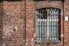 Forgotten building with bars on the window Royalty Free Stock Photos