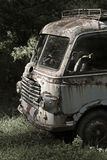 Forgotten car. Old  scrapped van parked in a lonely forest Royalty Free Stock Photo