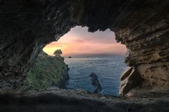 Sunset in a cave stock images